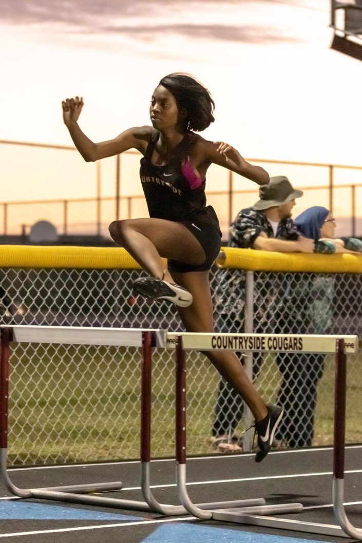 Andrew Tucker Photography - woman in jumping on obstacle