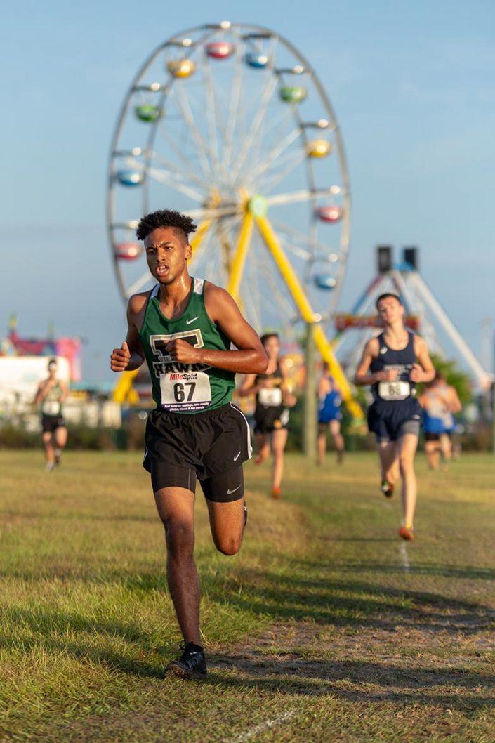 Andrew Tucker Photography - Men running on green grass track field